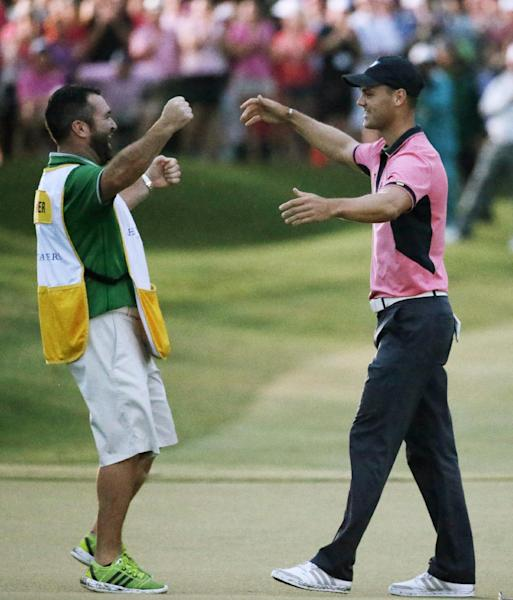 Martin Kaymer of Germany, left, celebrates with his caddie Craig Connelly after winningThe Players championship golf tournament at TPC Sawgrass, Sunday, May 11, 2014 in Ponte Vedra Beach, Fla. (AP Photo/John Raoux)