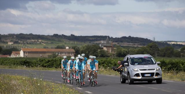 Team Astana with overall leader Vincenzo Nibali of Italy is filmed during a training on the second rest day of the Tour de France cycling race in Lignan-sur-Orb, southern France, Monday, July 21, 2014. (AP Photo/Peter Dejong)