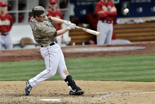 San Diego Padres' Jedd Gyorko connects for a two-run home run into the upper deck in left field against the Arizona Diamondbacks in the sixth inning of a baseball game in San Diego, Sunday, May 5, 2013. (AP Photo/Lenny Ignelzi)