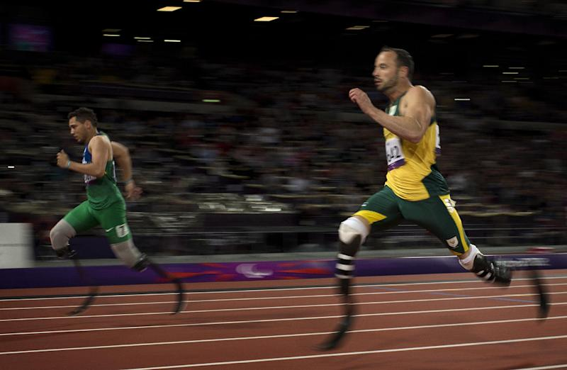 Brazil's Alan Fonteles Cardoso Oliveira, left, runs in to win the gold medal and beat South Africa's Oscar Pistorius, right, who took the silver medal in the men's 200m T44 category final during the athletics competition at the 2012 Paralympics, Sunday, Sept. 2, 2012, in London. (AP Photo/Emilio Morenatti)