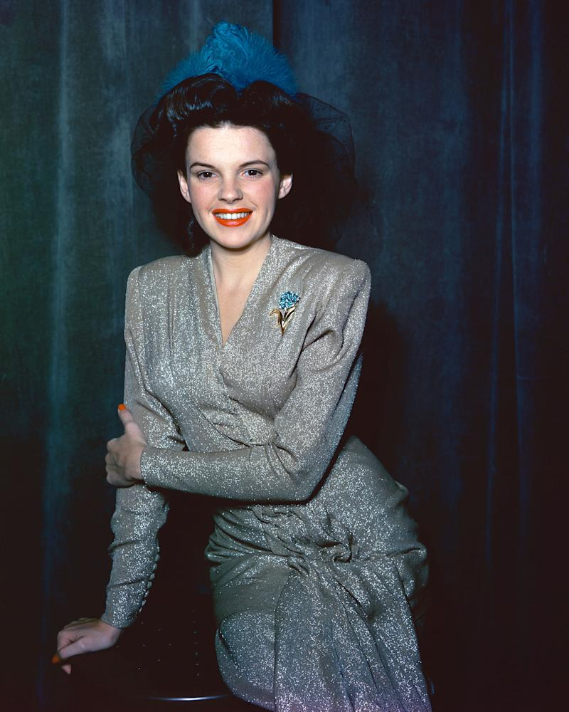 Garland in a sparkly silver dress sometime in 1945.
