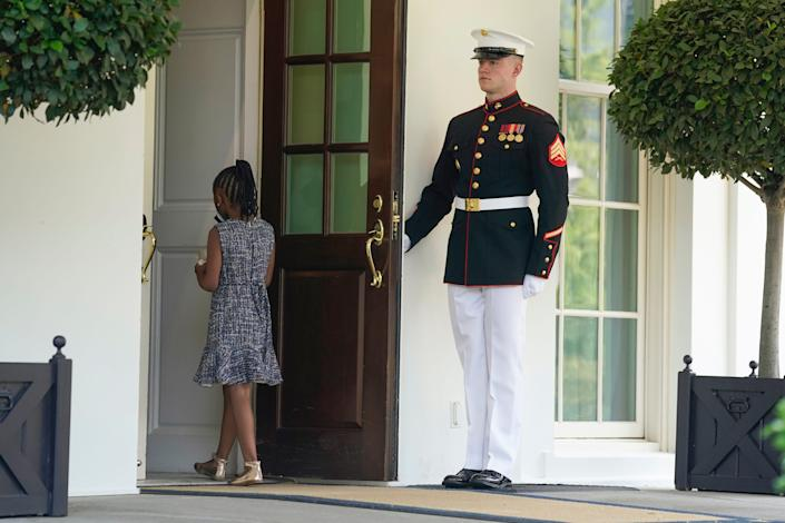 Gianna Floyd, the daughter of George Floyd, walks into the West Wing at the White House, Tuesday, May 25, 2021, in Washington. Members of the Floyd family were meeting with President Joe Biden.