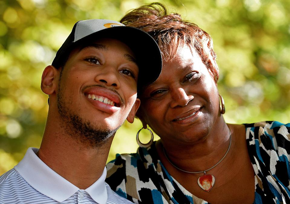Chancellor Lee Adams, left, and his grandmother Saundra Adams will attend Sunday's Panthers-Ravens game. (Getty Images)