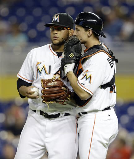 Miami Marlins starting pitcher Henderson Alvarez, left, talks with catcher Rob Brantly during a baseball game against the Atlanta Braves, Tuesday, July 9, 2013 in Miami. (AP Photo/Lynne Sladky)