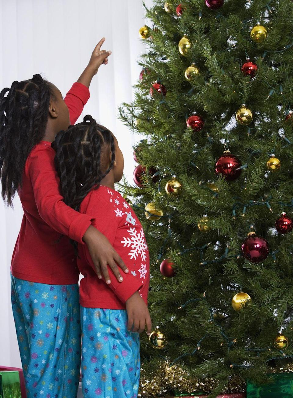 """<p>Keep it low key by cozying up by the fire in <a href=""""https://www.countryliving.com/shopping/g4956/matching-family-christmas-pajamas/"""" rel=""""nofollow noopener"""" target=""""_blank"""" data-ylk=""""slk:matching family Christmas pajamas"""" class=""""link rapid-noclick-resp"""">matching family Christmas pajamas</a>. There are plenty of affordable—and adorable!—options for everyone (including furry friends) making them the perfect uniform for a family photo. </p><p><a class=""""link rapid-noclick-resp"""" href=""""https://www.amazon.com/s/ref=nb_sb_ss_i_2_19?url=search-alias%3Daps&field-keywords=matching+christmas+pajamas&sprefix=matching+christmas+%2Cgrocery%2C127&crid=2201M58B1MH0T&tag=syn-yahoo-20&ascsubtag=%5Bartid%7C10050.g.25411840%5Bsrc%7Cyahoo-us"""" rel=""""nofollow noopener"""" target=""""_blank"""" data-ylk=""""slk:SHOP MATCHING PAJAMAS"""">SHOP MATCHING PAJAMAS</a></p>"""