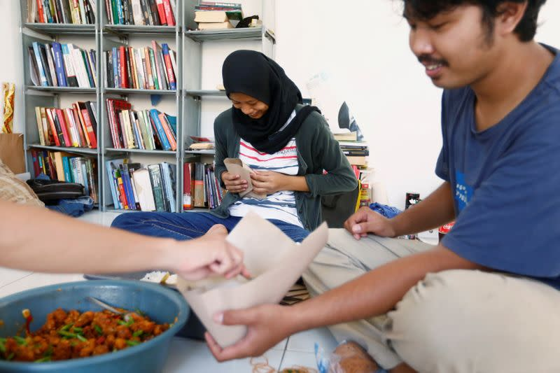 Volunteers prepare free food for distribution, amid the coronavirus disease (COVID-19) outbreak in Jakarta