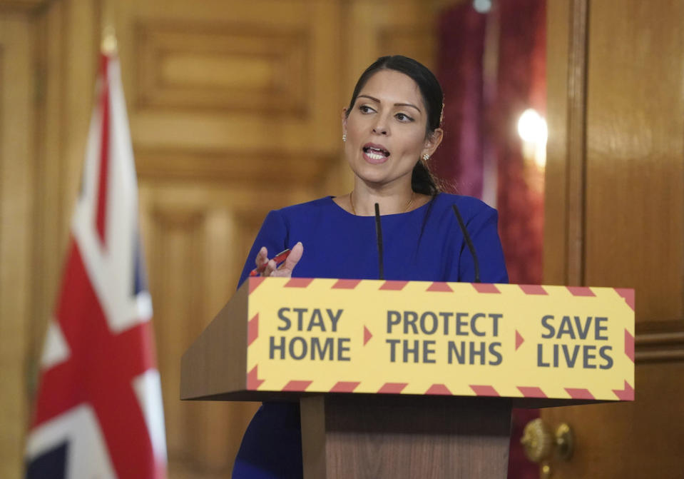 In the photo provided by 10 Downing Street, Britain's Home Secretary Priti Patel speaks, during a coronavirus briefing in Downing Street, London, Saturday April 25, 2020. (Pippa Fowles/10 Downing Street via AP)