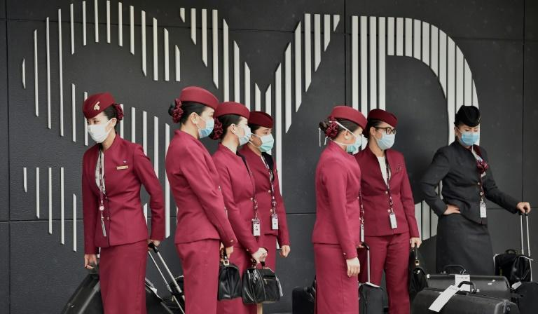 Qatar Airways crew prepare to enter Sydney international airport to fly a repatriation flight back to France on April 2, 2020, amid the COVID-19 coronavirus pandemic