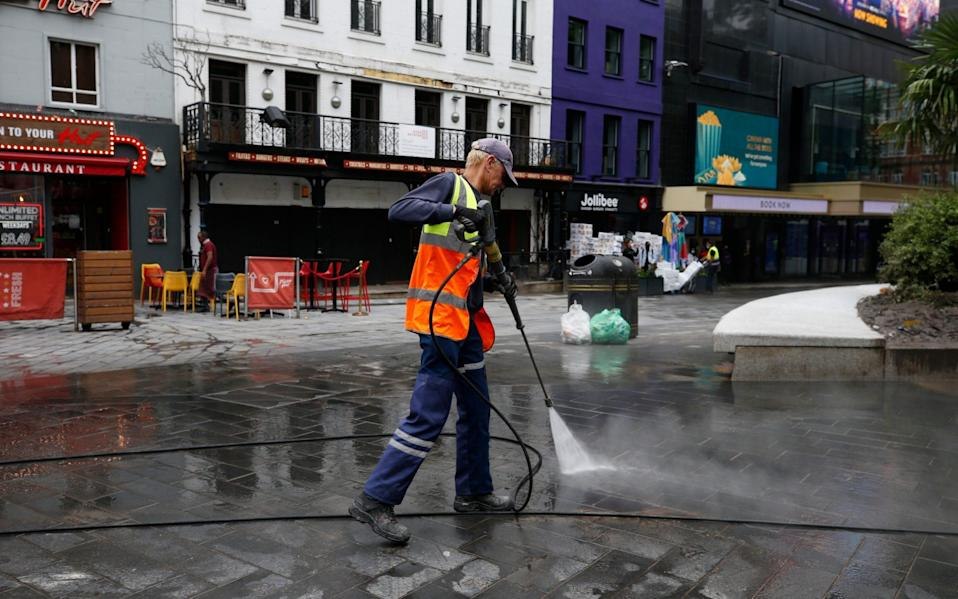 A Cit of Westminster worker cleans up after football fans at Leicester Square on June 19, 2021 in London, England. England and Scotland drew 0-0 in the Euro 2020 match at Wembley - GETTY IMAGES