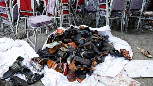 PHOTO: The shoes of victims are seen outside a damaged wedding hall after a blast in Kabul, Afghanistan, on Saturday, Aug. 18, 2019. (Mohammad Ismail/Reuters)