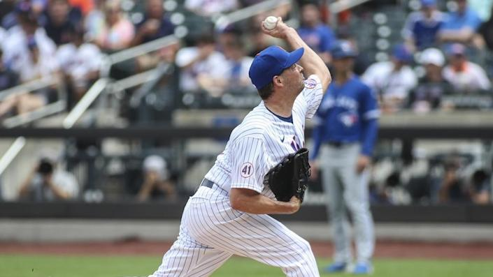 Jul 25, 2021; New York City, New York, USA; New York Mets pitcher Rich Hill (14) pitches in the first inning against the Toronto Blue Jays at Citi Field.