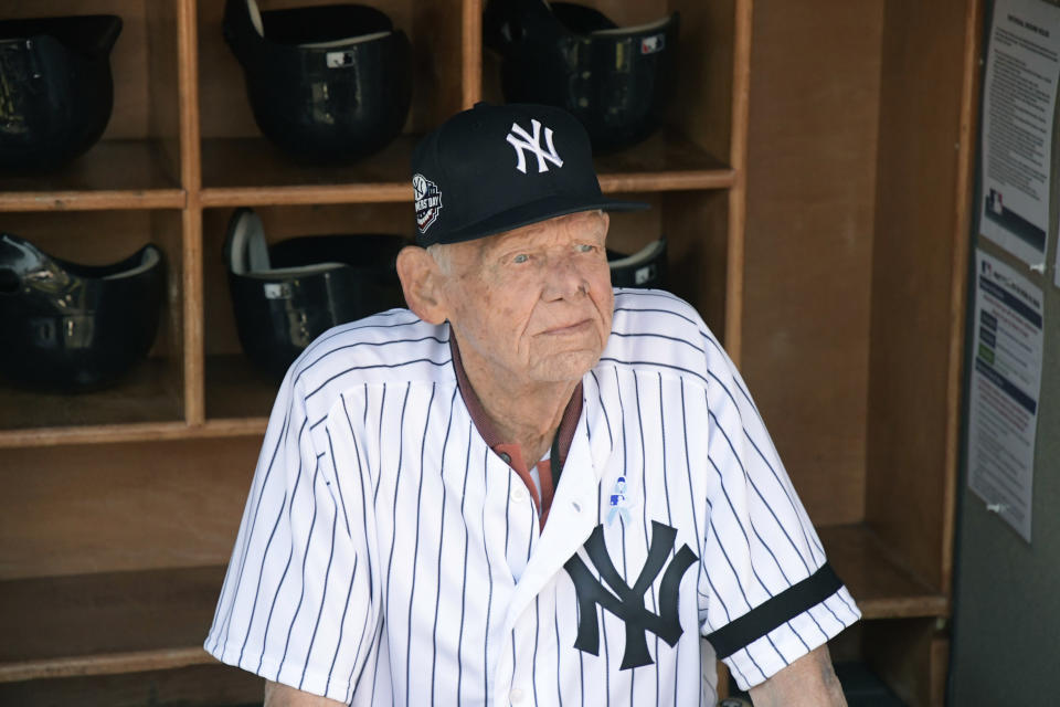 FILE - In this Sunday, June 17, 2018, file photo, New York Yankees' Don Larsen sits in the dugout before the Yankees' Old-Timers' Day baseball game at Yankee Stadium in New York. Larsen, the journeyman pitcher who reached the heights of baseball glory in 1956 for the Yankees when he threw a perfect game and only no-hitter in World Series history, died Wednesday, Jan. 1, 2020. He was 90. (AP Photo/Bill Kostroun, File)