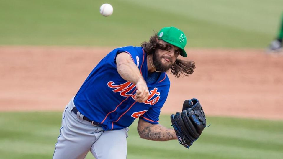 Robert Gsellman fires a pitch wearing green hat at spring training, close crop