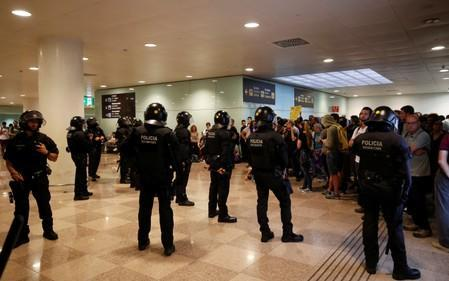 Protesters block access from metro gateway to the airport due to a verdict in a trial over a banned independence referendum, in Barcelona