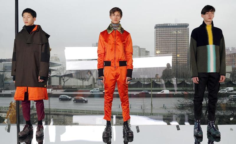 Models present creations by Kenzo during the menswear Fall/Winter 2015 ready-to-wear collection fashion show on January 24, 2015 in Paris