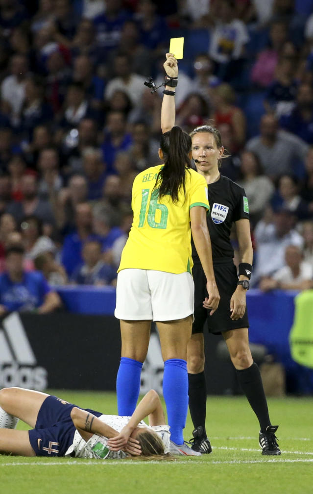 Beatriz Zaneratto Joao of Brazil receives a yellow card from referee Marie-Soleil Beaudoin of Canada during the 2019 FIFA Women's World Cup France Round Of 16 match between France and Brazil at Stade Oceane on June 23, 2019 in Le Havre, France. (Photo by Jean Catuffe/Getty Images)
