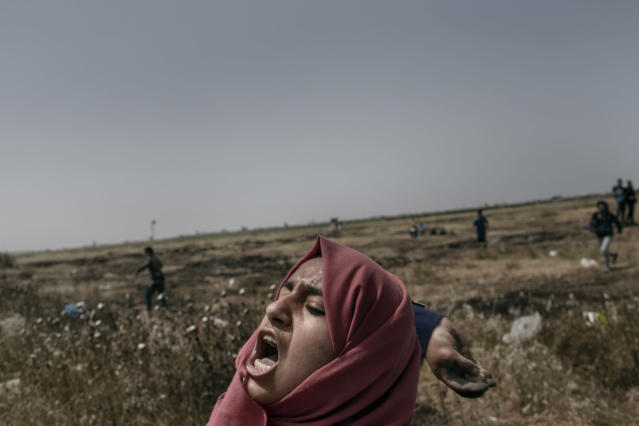 "<p>A Palestinian woman throws a stone toward Israeli troops during the ""Great March of Return"" protests at the Eastern Gaza City's border with Israel on April 13, 2018. (Photo: Fabio Bucciarelli for Yahoo News) </p>"