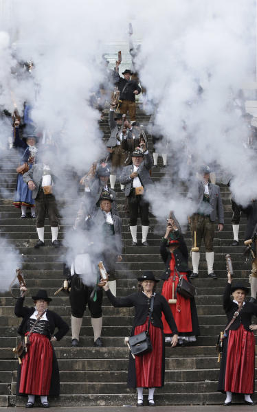 Bavarian riflemen and women in traditional costumes fire their muzzle loading guns in Munich, southern Germany, Sunday, Oct. 7, 2012. Members of various shooting clubs of the region met for a salute on the last day of the famous Oktoberfest beer festival. (AP Photo/Matthias Schrader)
