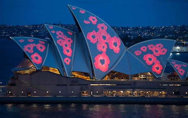 <p>Poppies are projected onto the sails of the Opera House on Nov. 11, 2017 in Sydney, Australia. (Photo: James D. Morgan/Getty Images) </p>