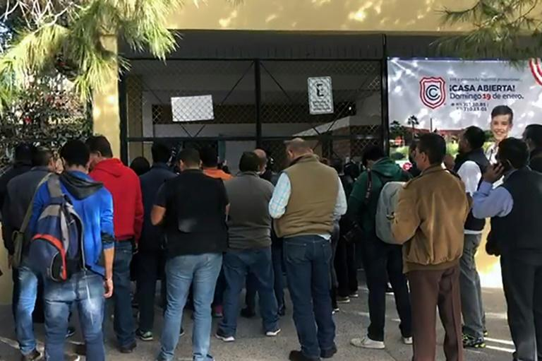 Relatives of schoolchildren gathered outside the elementary school in Mexico for news after a student shot and killed a teacher and wounded six others, and then apparently killed himself in Torreon