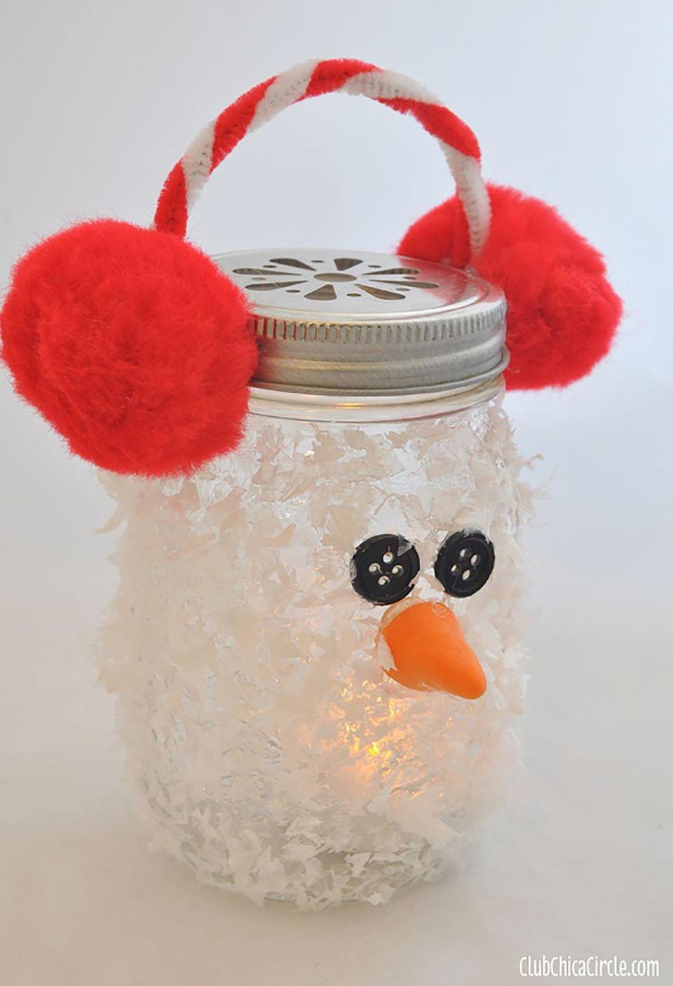 """<p>Rather than decorating the inside of a Mason jar, this craft calls for adhering <a href=""""https://www.amazon.com/FloraCraft-4-Liters-Plastic-Snow/dp/B000XZY0OY/?tag=syn-yahoo-20&ascsubtag=%5Bartid%7C10050.g.2132%5Bsrc%7Cyahoo-us"""" rel=""""nofollow noopener"""" target=""""_blank"""" data-ylk=""""slk:faux snow"""" class=""""link rapid-noclick-resp"""">faux snow</a>, buttons, and a nose made of air-dry clay to the outside. The earmuffs are made with a pipe cleaner and pom poms. </p><p><strong>Get the tutorial at <a href=""""http://club.chicacircle.com/snowman-mason-jar-luminary-ornament-and-decoart-giveaway/"""" rel=""""nofollow noopener"""" target=""""_blank"""" data-ylk=""""slk:Club Chica Circle"""" class=""""link rapid-noclick-resp"""">Club Chica Circle</a>.</strong></p><p><a class=""""link rapid-noclick-resp"""" href=""""https://www.amazon.com/FloraCraft-4-Liters-Plastic-Snow/dp/B000XZY0OY/?tag=syn-yahoo-20&ascsubtag=%5Bartid%7C10050.g.2132%5Bsrc%7Cyahoo-us"""" rel=""""nofollow noopener"""" target=""""_blank"""" data-ylk=""""slk:SHOP ARTIFICIAL SNOW"""">SHOP ARTIFICIAL SNOW</a></p>"""