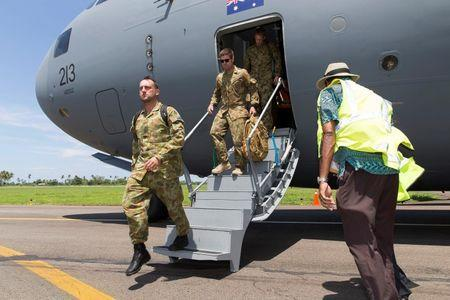 Australian Army troops disembark from a Royal Australian Air Force C-17A aircraft after landing at Fiji's Nausori International Airport to assist in Cyclone Winston recovery efforts, in this picture supplied by the Australian Defence Force February 24, 2016. REUTERS/Australian Defence Force/Handout via Reuters