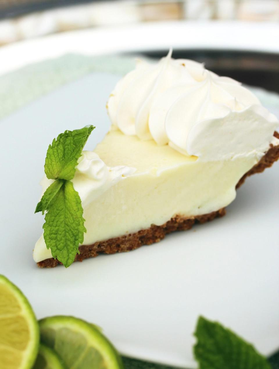 """<p>Key lime pie is one of <a href=""""https://www.thedailymeal.com/cook/iconic-state-desserts-gallery?referrer=yahoo&category=beauty_food&include_utm=1&utm_medium=referral&utm_source=yahoo&utm_campaign=feed"""" rel=""""nofollow noopener"""" target=""""_blank"""" data-ylk=""""slk:the most iconic desserts in America"""" class=""""link rapid-noclick-resp"""">the most iconic desserts in America</a>, especially if you've spent any time in Florida. This tart, cream-based pie filling is balanced with a fun new addition to this recipe: a chocolate crust.</p> <p><a href=""""https://www.thedailymeal.com/recipes/chocolate-crusted-key-lime-pie-recipe?referrer=yahoo&category=beauty_food&include_utm=1&utm_medium=referral&utm_source=yahoo&utm_campaign=feed"""" rel=""""nofollow noopener"""" target=""""_blank"""" data-ylk=""""slk:For the Chocolate-Crusted Key Lime Pie recipe, click here."""" class=""""link rapid-noclick-resp"""">For the Chocolate-Crusted Key Lime Pie recipe, click here.</a></p>"""