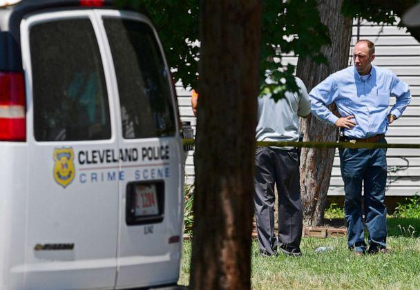 PHOTO: Police officers work at the scene where several bodies were found, Tuesday, July 9, 2019, in Cleveland. (David Dermer/AP)