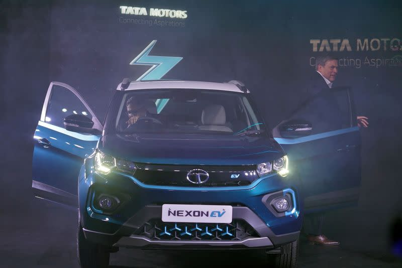 FILE PHOTO: Natarajan Chandrasekaran, Chairman of Tata Sons, sits inside the company's electric sport-utility vehicle (SUV) Nexon EV next to Guenter Butschek, CEO and Managing Director at Tata Motors, during the launch of the vehicle in Mumbai