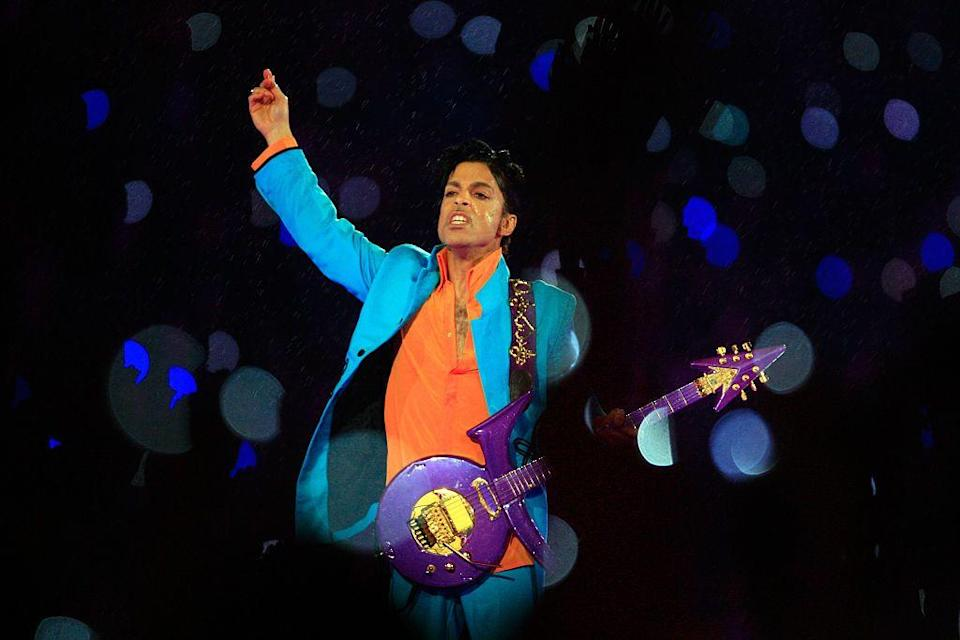 """<p>Prince paired a turquoise suit with an orange shirt and his iconic purple guitar. </p><p><a class=""""link rapid-noclick-resp"""" href=""""https://www.youtube.com/watch?v=-WYYlRArn3g&ab_channel=MusicEntertainment"""" rel=""""nofollow noopener"""" target=""""_blank"""" data-ylk=""""slk:WATCH NOW"""">WATCH NOW</a></p>"""