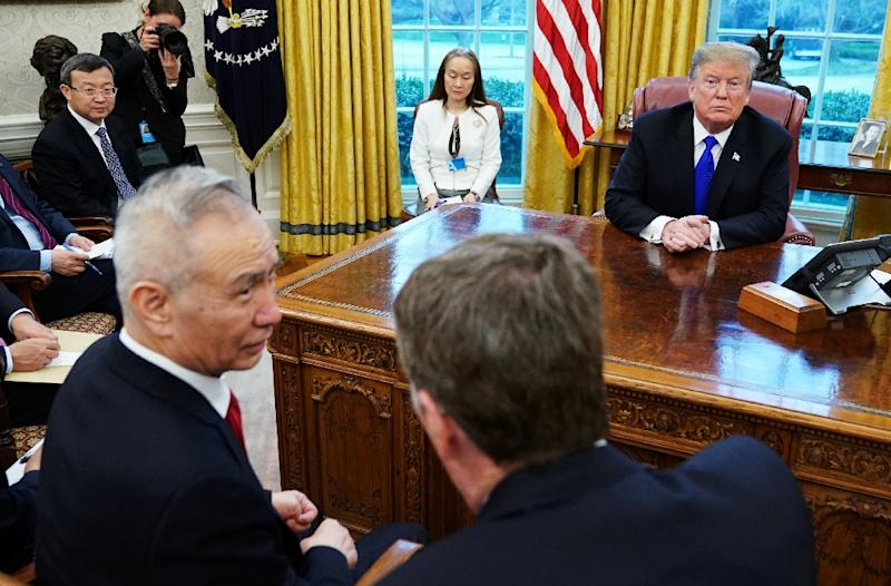 US President Donald Trump watches as China's Vice Premier Liu He (L) speaks with US Trade Representative Robert Lighthizer (R) in the Oval Office on February 22, 2019