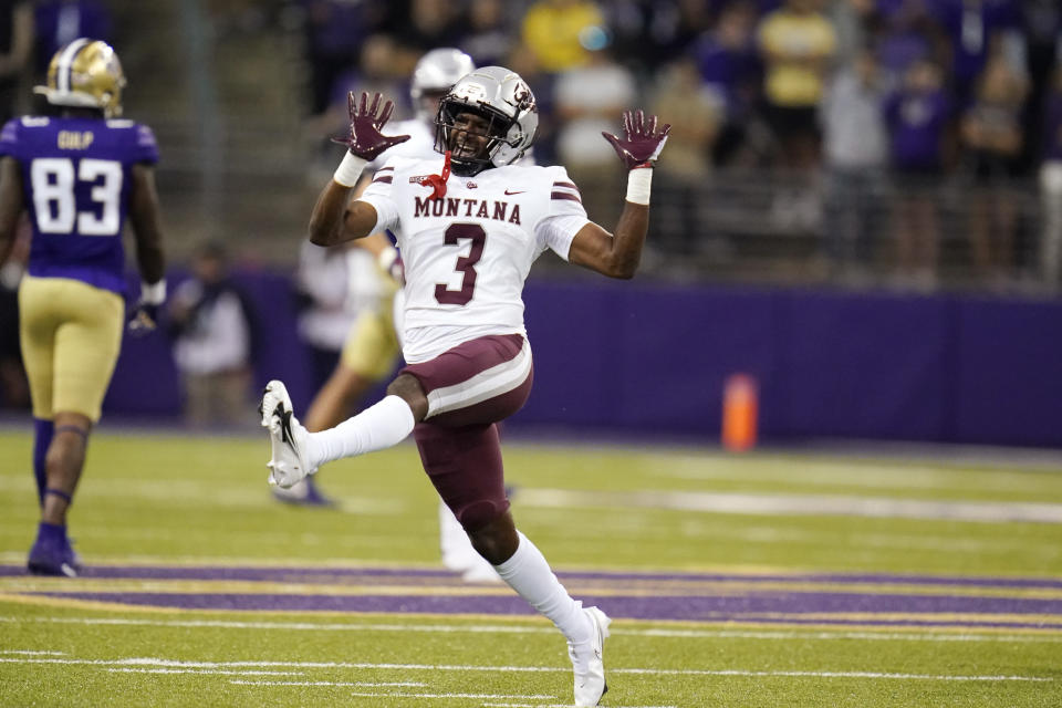 Montana's TraJon Cotton celebrates after the team stopped Washington on fourth down late in the second half of an NCAA college football game Saturday, Sept. 4, 2021, in Seattle. (AP Photo/Elaine Thompson)