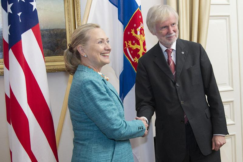U.S. Secretary of State Hillary Rodham Clinton shakes hands with Finnish Foreign Minister Erkki Tuomioja, Wednesday, June 27, 2012, at the Government Banquet Hall in Helsinki, Finland. (AP Photo/Haraz N. Ghanbari, Pool)