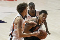 Nebraska guard Shamiel Stevenson looks for a shot as he is pressured by Illinois forward Coleman Hawkins, left, and guard Da'Monte Williams during the first half of an NCAA college basketball game Thursday, Feb. 25, 2021, in Champaign, Ill. (AP Photo/Holly Hart)
