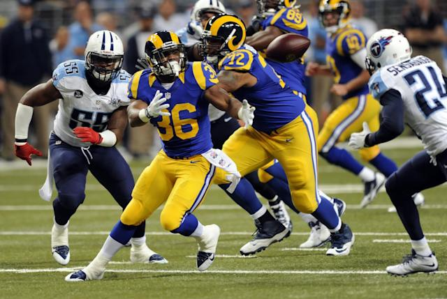 St. Louis Rams running back Benny Cunningham (36) fumbles as Tennessee Titans cornerback Coty Sensabaugh, right, prepares to recover the fumble and Titans linebacker Zach Brown, left, watches during the first quarter of an NFL football game Sunday, Nov. 3, 2013, in St. Louis. (AP Photo/L.G. Patterson)
