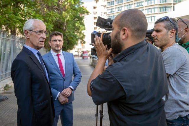 Jean Yves Le Borgne, left, speaks with journalists outside the Justice Palace in Beirut, Lebanon