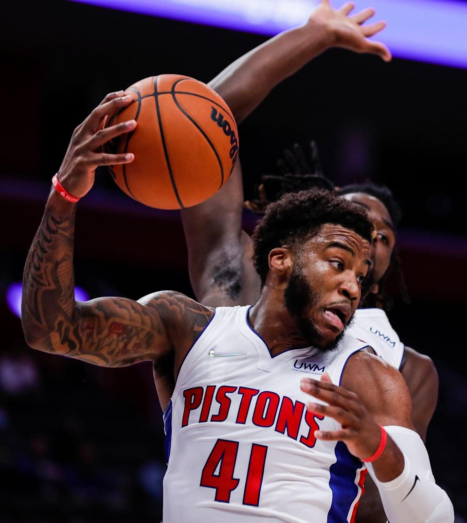 Detroit Pistons forward Saddiq Bey (41) grabs a rebound against San Antonio Spurs during the first half of a preseason game at Little Caesars Arena in Detroit on Wednesday, Oct. 6, 2021.