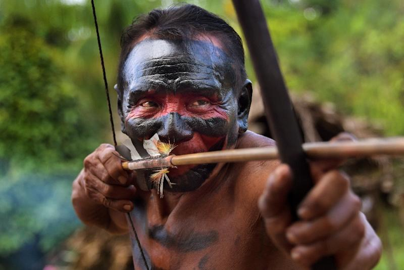 A man aims a bow-and-arrow at the Waiapi indigenous reserve in the Manilha village, in Amapa state, Brazil (AFP Photo/Apu Gomes)