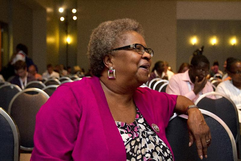 "In this photo taken July 25, 2012, Carolyn Massey, 54, of Laurel, Md., who has HIV, waits for the start of a panel on ""Aging With HIV,"" which she is speaking on, at the International AIDS Conference in Washington. AIDS is graying: By the end of the decade, the government estimates, more than half of Americans living with HIV will be over 50. Even in developing countries, more people with the AIDS virus are surviving to middle age and beyond. (AP Photo/Jacquelyn Martin)"