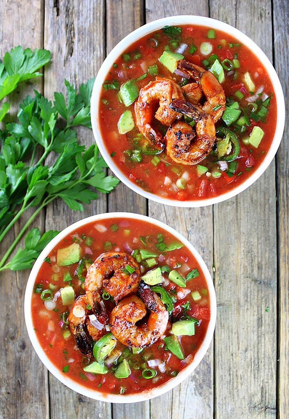 """<p>Enjoy the ultimate tastes of summer with this soup recipe. An added bonus: It's dairy-free <em>and</em> low-carb! </p><p><strong>Get the recipe at <a href=""""https://tasteandsee.com/classic-gazpacho-with-spicy-grilled-shrimp-recipe"""" rel=""""nofollow noopener"""" target=""""_blank"""" data-ylk=""""slk:Taste and See"""" class=""""link rapid-noclick-resp"""">Taste and See</a>.</strong></p>"""