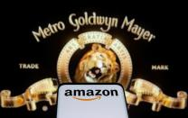 FILE PHOTO: Smartphone with Amazon logo is seen in front of displayed MGM logo in this illustration taken