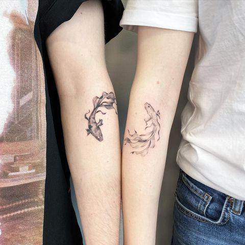 """<p>The incredible detailing in these <a href=""""https://www.cosmopolitan.com/entertainment/celebs/a33595145/cara-delevingne-kaia-gerber-feet-tattoo/"""" rel=""""nofollow noopener"""" target=""""_blank"""" data-ylk=""""slk:matching"""" class=""""link rapid-noclick-resp"""">matching</a> koi tattoos is beyond impressive. Pro tip: Make the look your own by opting for slightly different shading.</p><p><a href=""""https://www.instagram.com/p/CIileKYjJyV/"""" rel=""""nofollow noopener"""" target=""""_blank"""" data-ylk=""""slk:See the original post on Instagram"""" class=""""link rapid-noclick-resp"""">See the original post on Instagram</a></p>"""