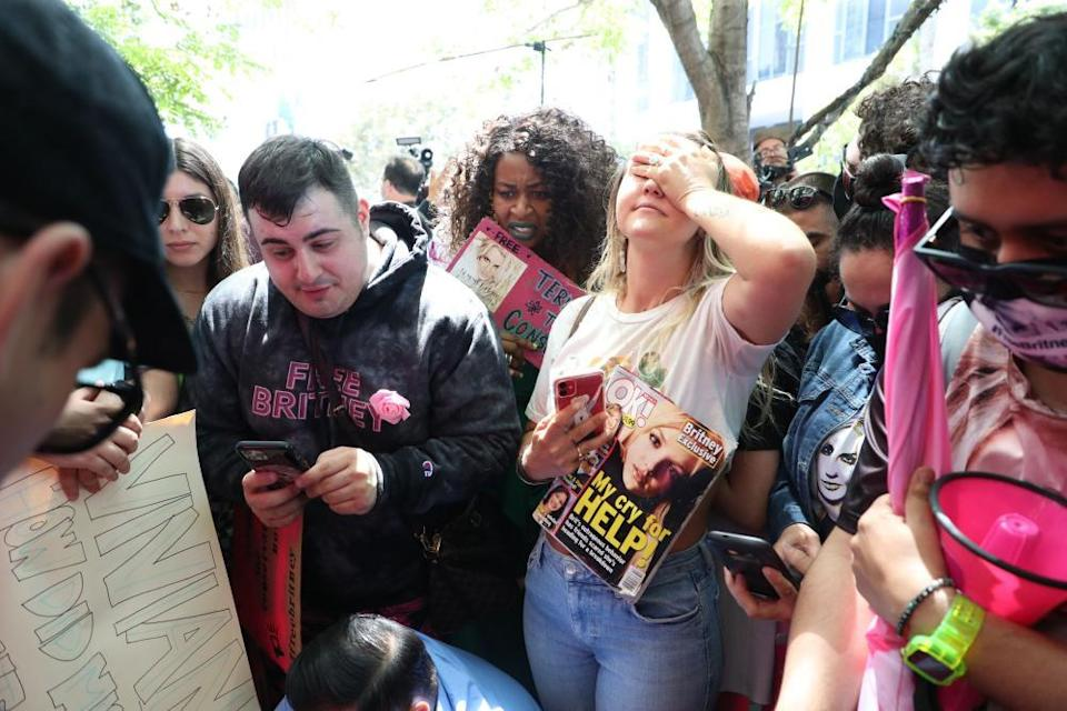 Britney Spears fans react outside the LA courthouse as they listen to a live feed from the hearing on the pop singer's conservatorship.