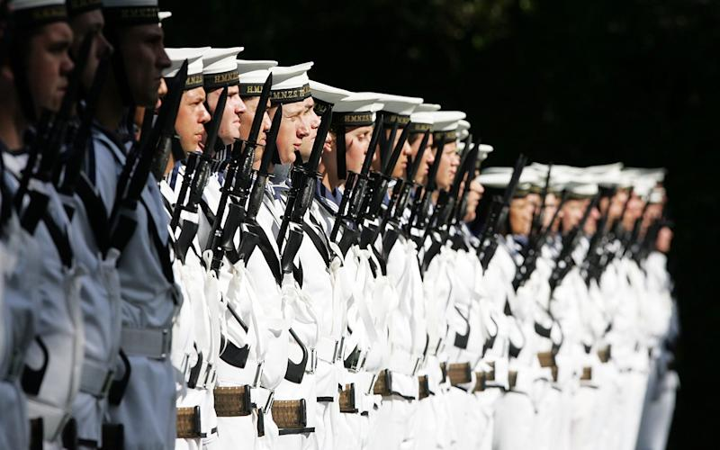 Members of the Royal New Zealand Navy line up at a ceremony - Getty Images AsiaPac