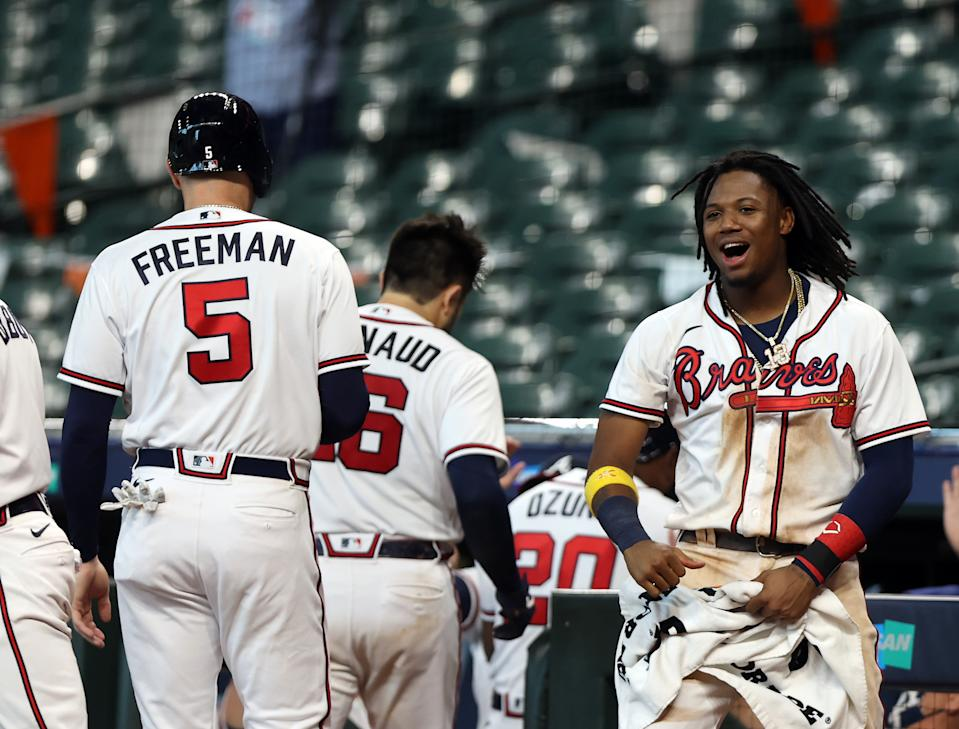 HOUSTON, TX - OCTOBER 06: Ronald Acuna Jr. #13 of the Atlanta Braves celebrates with Freddie Freeman #5 after Travis dArnaud #16 hit a three-run home run in the seventh inning of Game 1 of the NLDS between the Atlanta Braves and the Miami Marlins at Minute Maid Park on Tuesday, October 6, 2020 in Houston, Texas. (Photo by Michael Starghill/MLB Photos via Getty Images)
