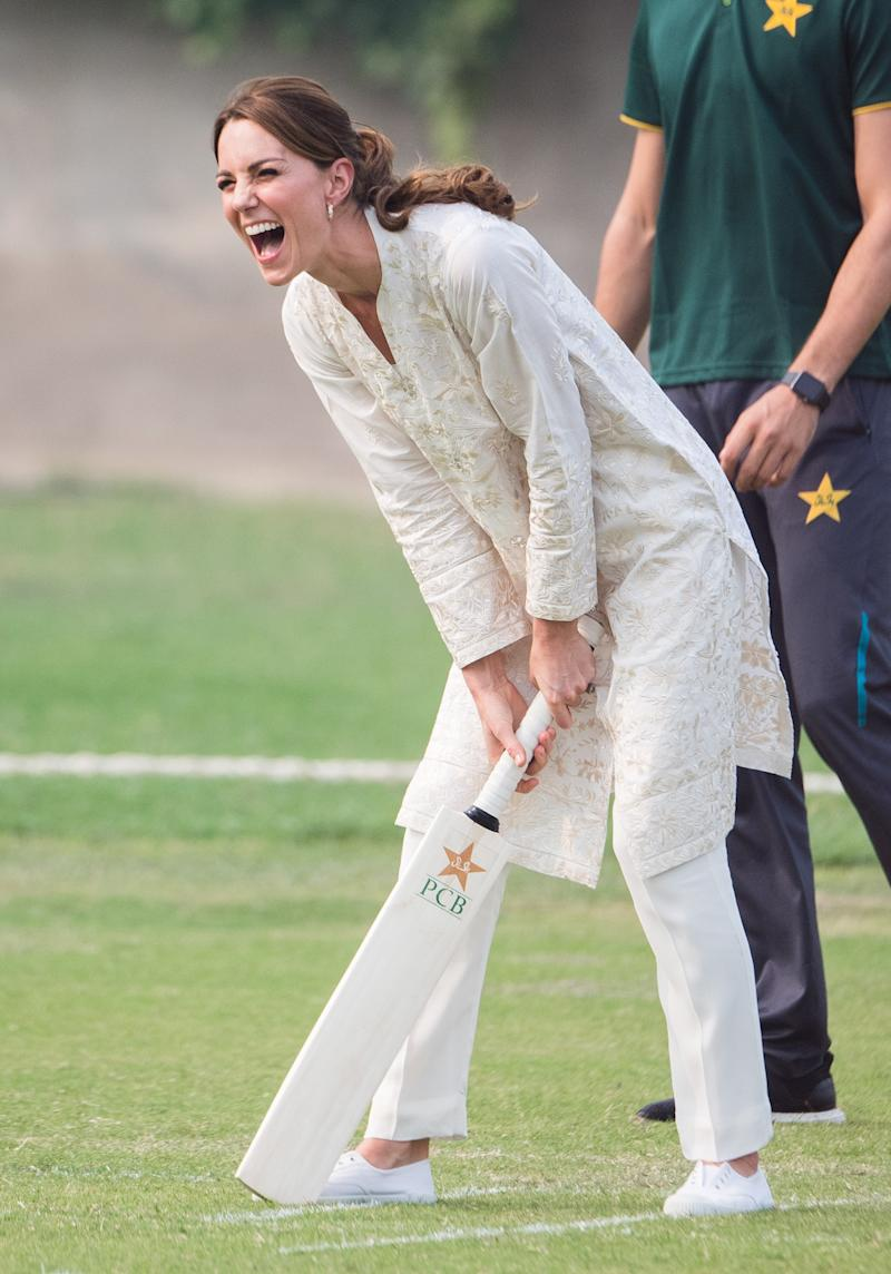 Kate Middleton takes part in a game of cricket as she visits the National Cricket Academy in Lahore on October 17, 2019 in Lahore, Pakistan. Photo by Samir Hussein/WireImage.