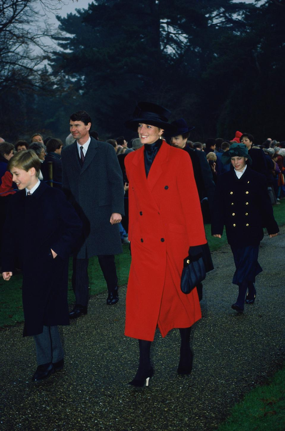 Princess Diana got into the festive mood in 1993 in this bright red coat with matching black accessories. Photo: Getty Images