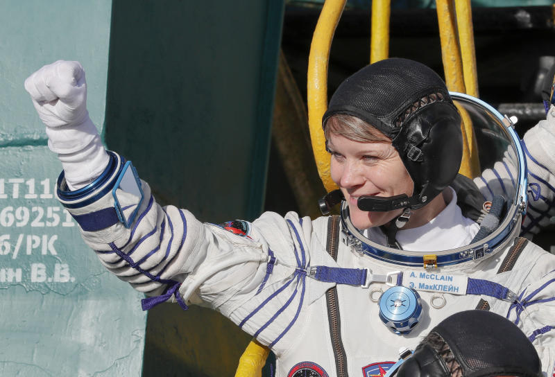 NASA astronaut Anne McClain, a member of the International Space Station expedition 58/59, gestures as she boards the Soyuz MS-11 spacecraft shortly before the launch in December 2018. She's accused of committing the first crime in space.