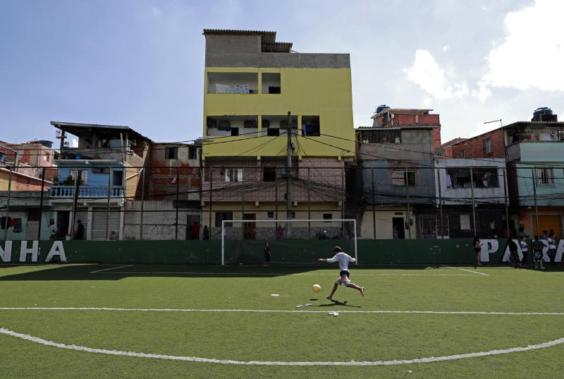 SAO PAULO, BRAZIL - MARCH 24: A kid play soccer during training to distribute donated food to residents of Paraisópolis favela on March 24, 2020 in Sao Paulo, Brazil. Paraisopolis is the second largest favela in the city of Sao Paulo housing more than 100 thousand people and so far has five coronavirus (COVID-19) positive cases reported. According to the Ministry of health, Brazil has 2201 confirmed cases infected with the coronavirus (COVID-19) and at least 46 recorded deceases. (Photo by Rodrigo Paiva/Getty Images)