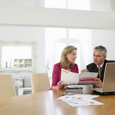 Woman-with-financial-advisor-at-table_web